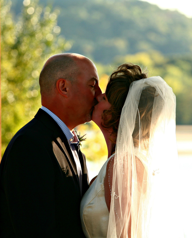 Kiss the bride - beautiful riverside ceremony in Wisconsin