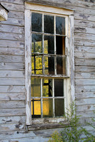 Weathered building and old window panes in Amana Iowa